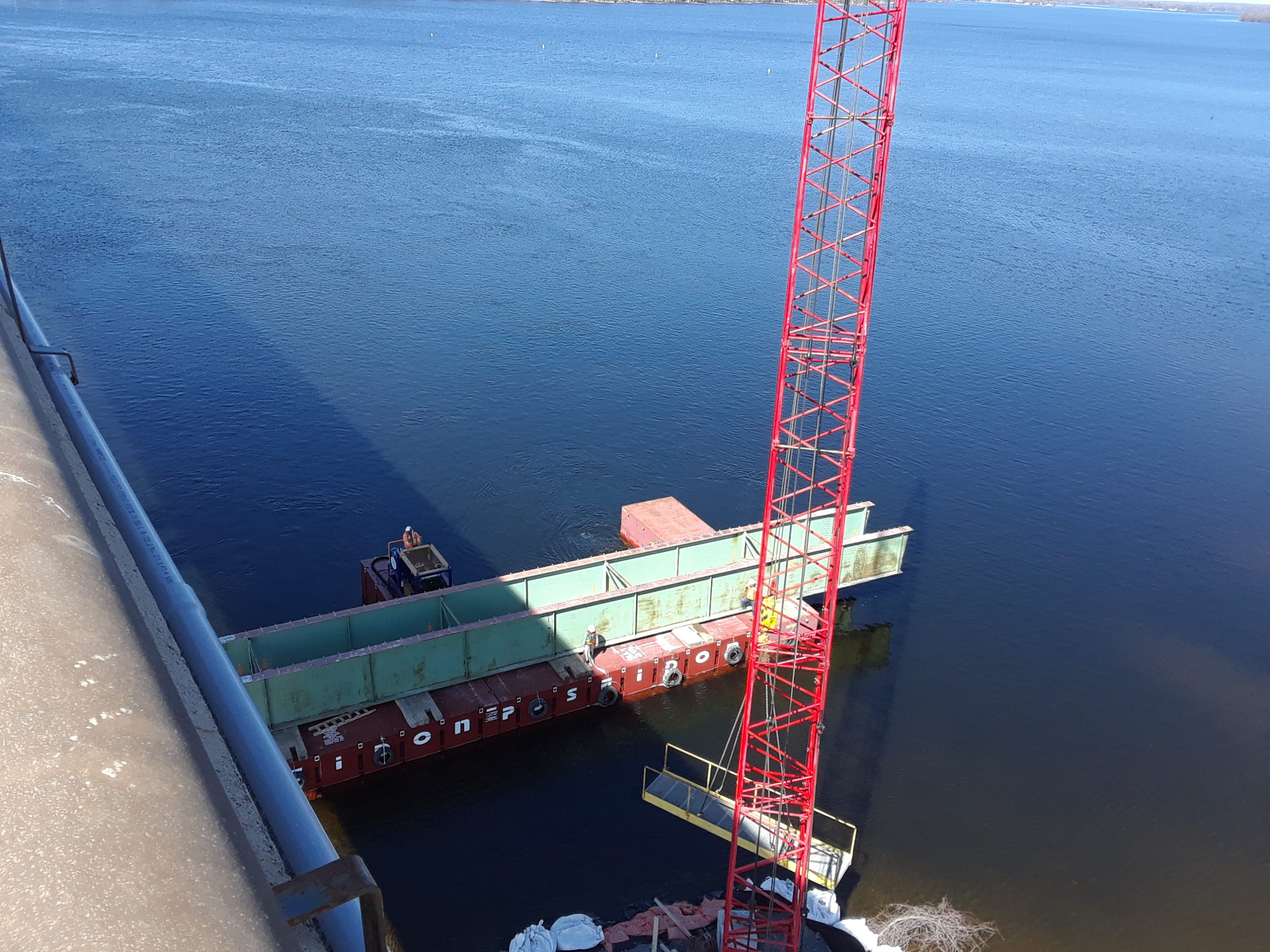 Second section of removed girder being brought to shore / crane waiting with walkway for barge access