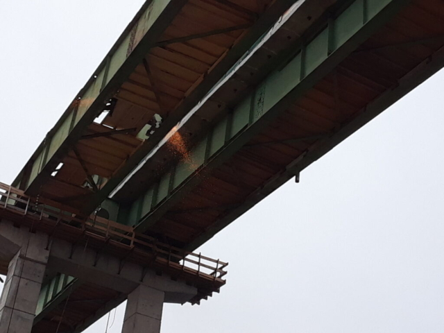 Girders being cut for removal