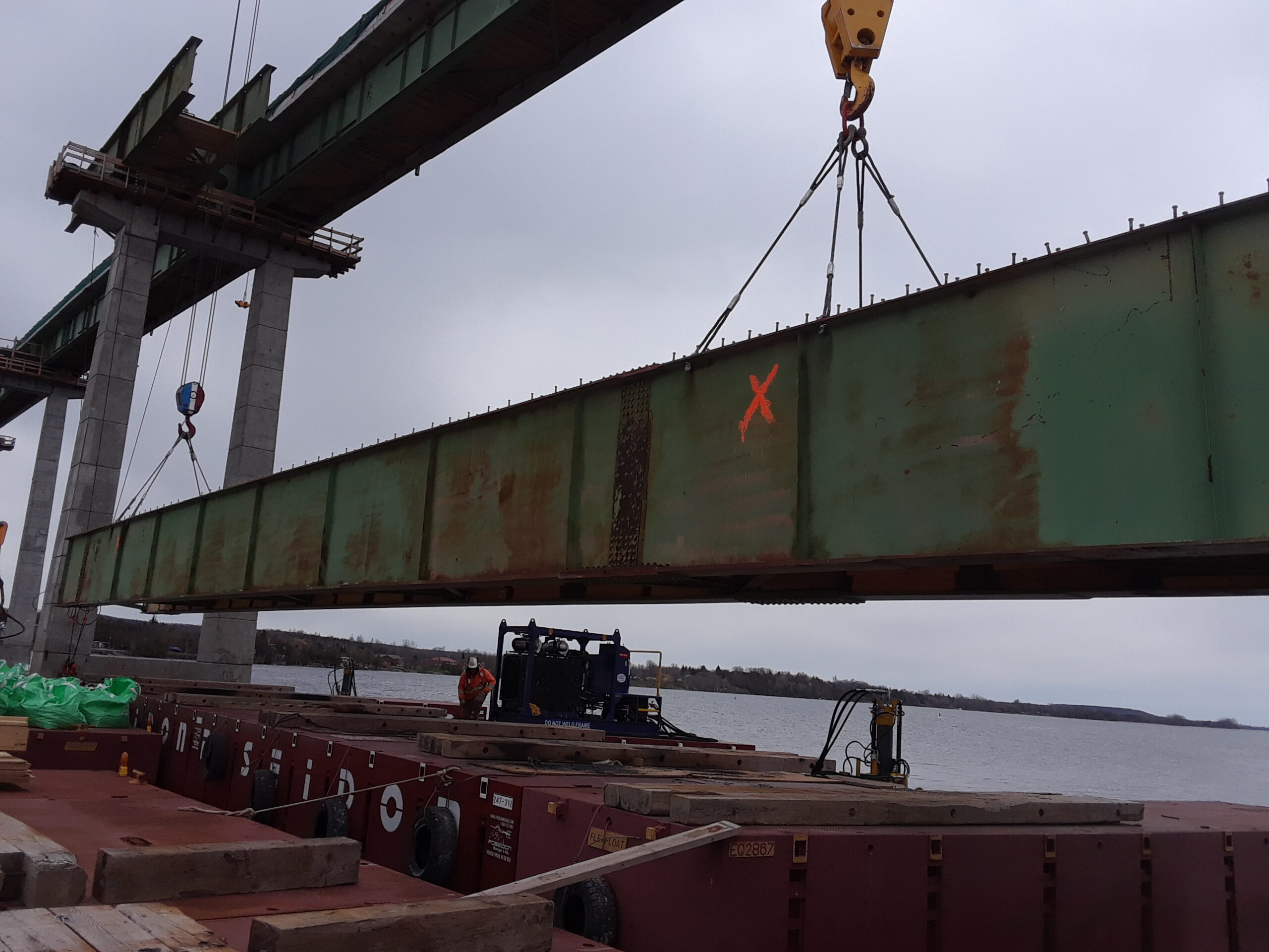 Girder section being lowered onto the barge