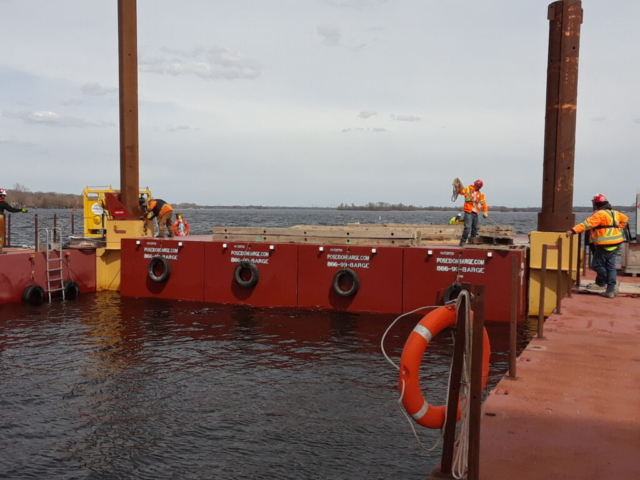 Barge being moved into place for girder removal