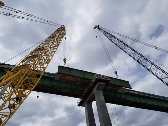 Ready to lift the final section of girder from the top of pier 6