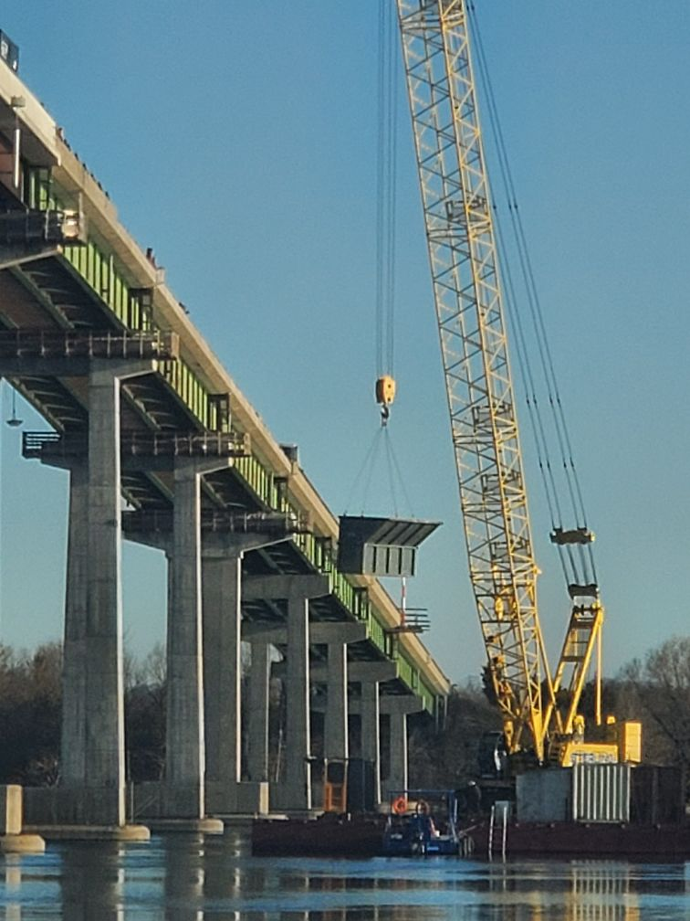 Containment bin being lowered from the bridge