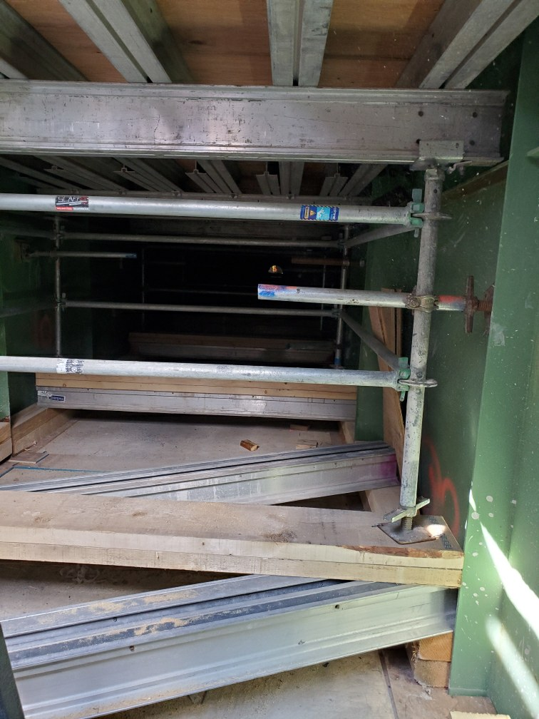 Containment scaffolding between false decking and bridge deck