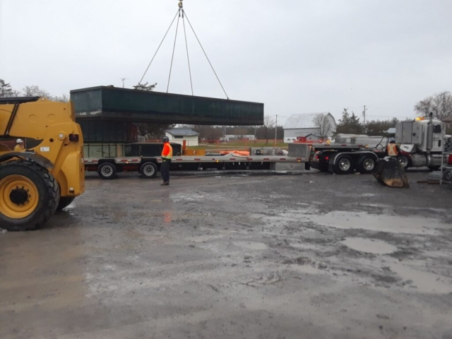 Barge section being lifted to the truck for removal from site