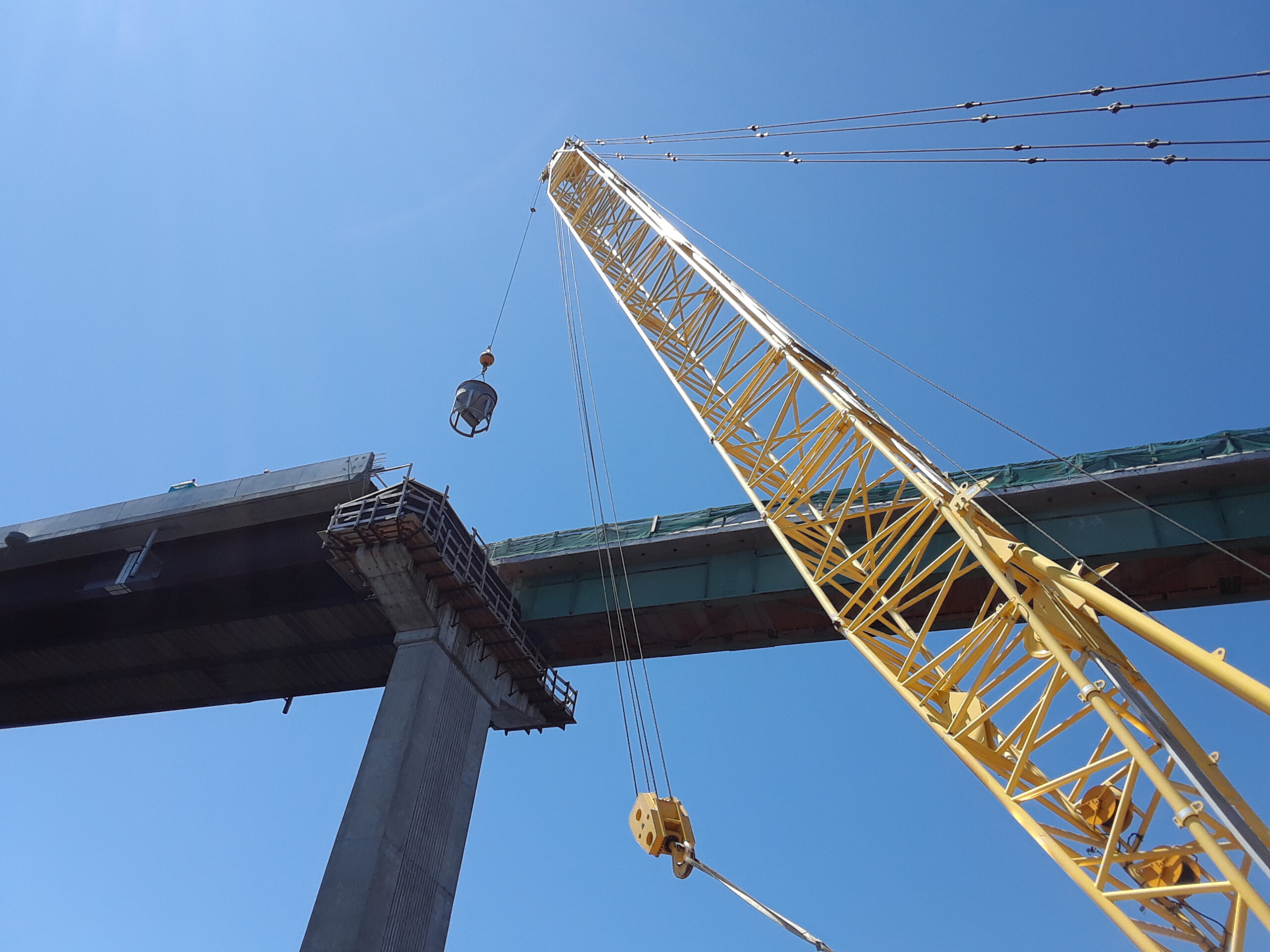 Hopper being raised for pier top concrete placement