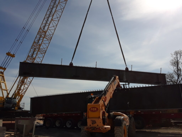 First pieces of approach girder being offloaded from the truck