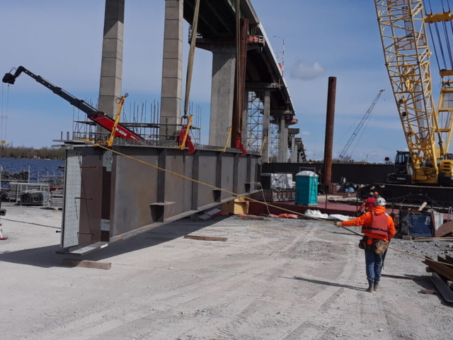 Lifting the second piece of the approach girder for assembly on the barge