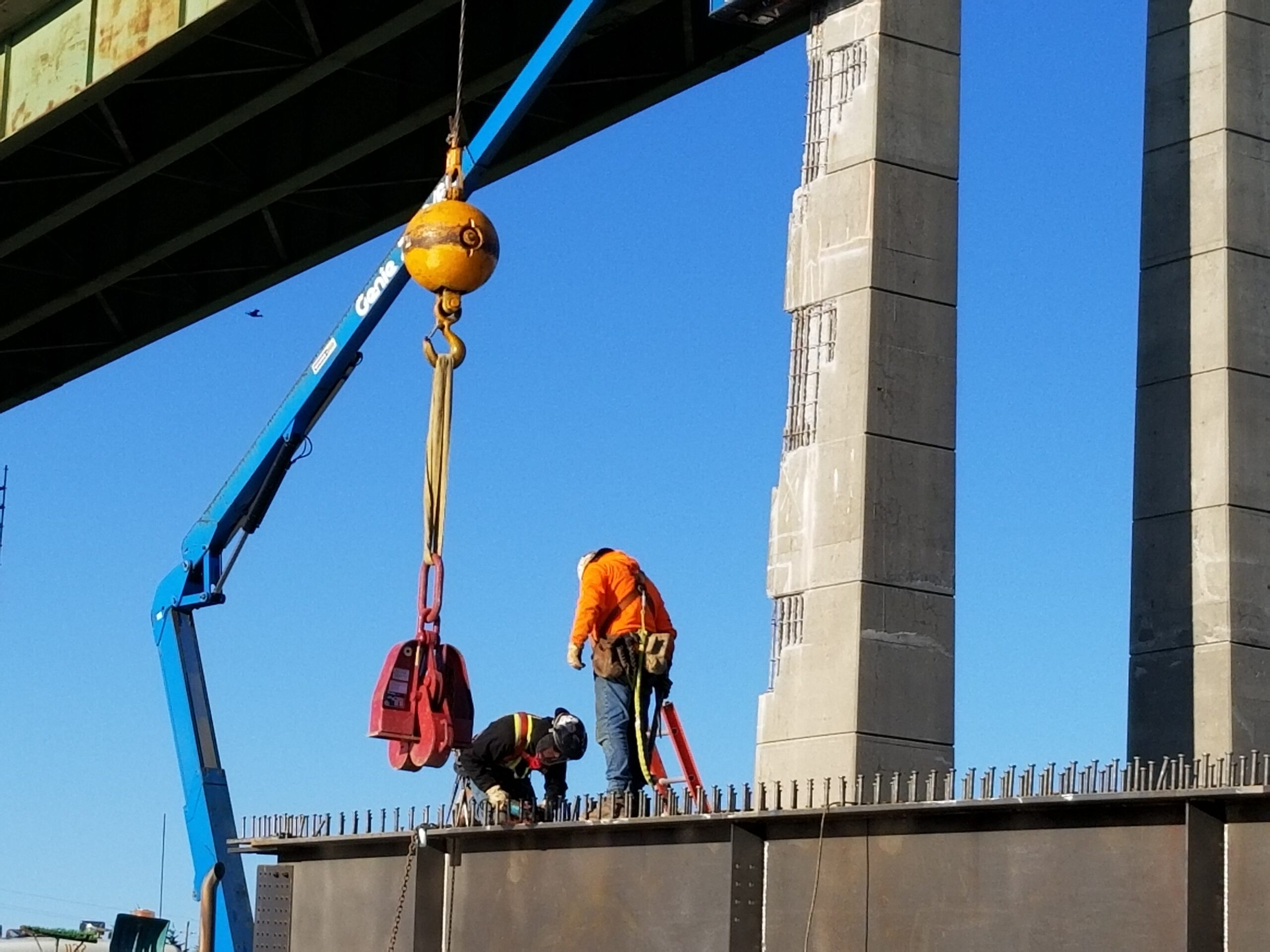 Preparing to attach the Crosby Clamp to lift the girder
