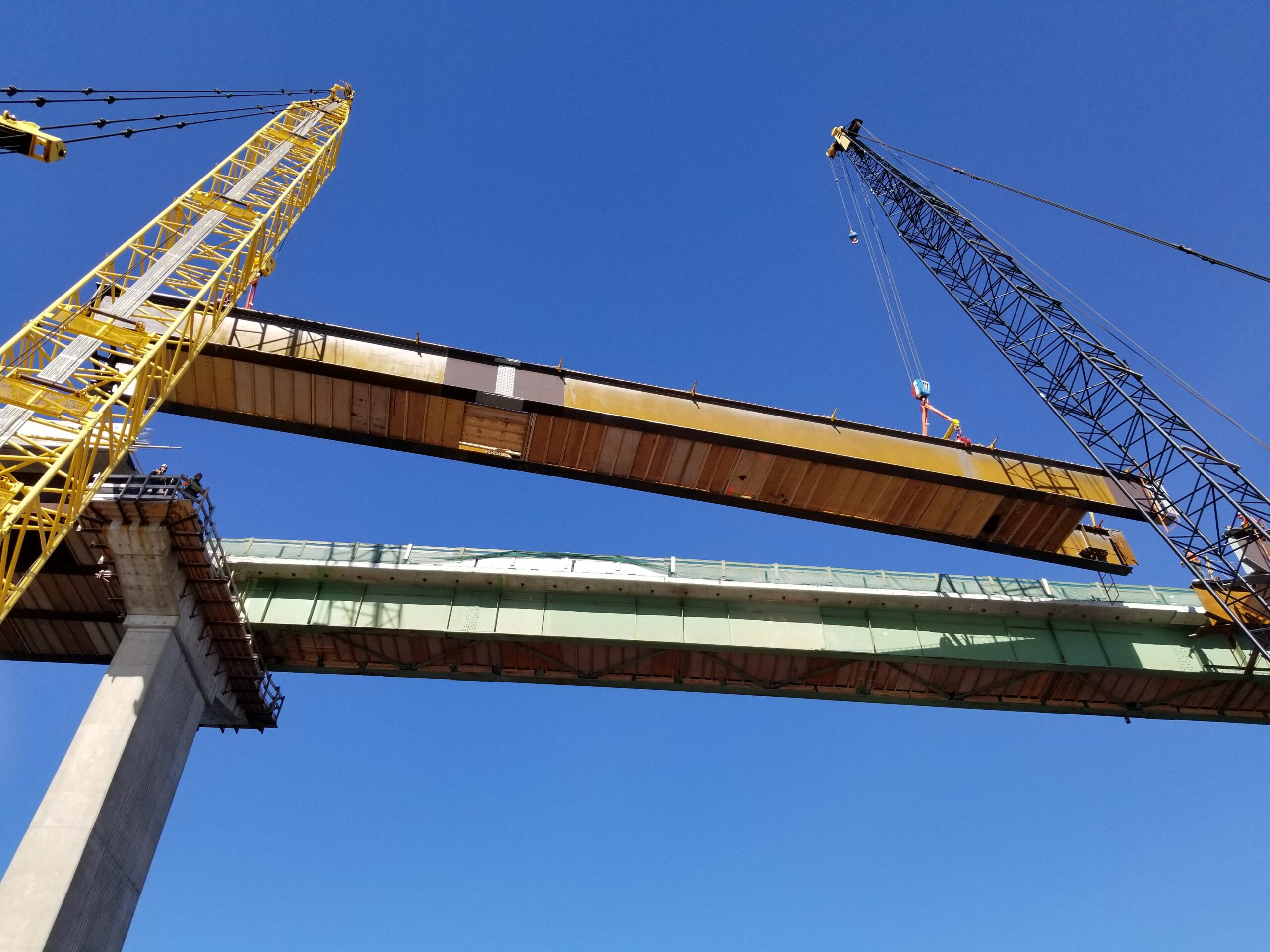 Approach girder being lowered into place