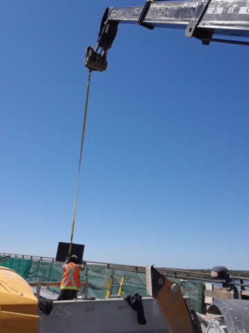Bearing plate being lowered onto pier top 5