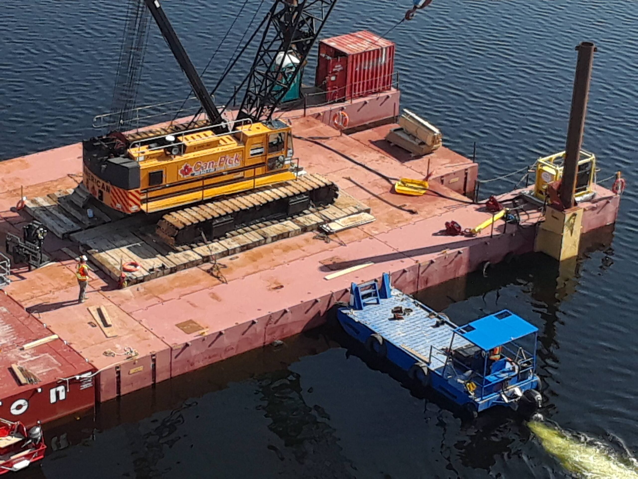 Moving the crane barge into place for girder placement