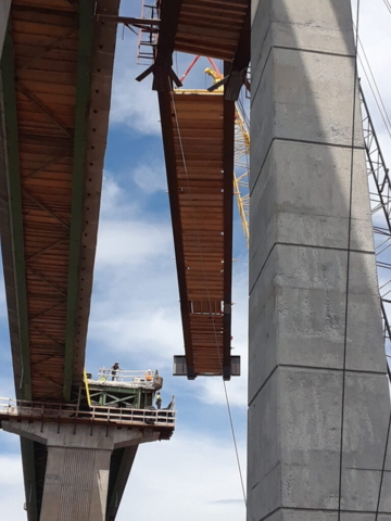 View from below of the approach girder being moved into place