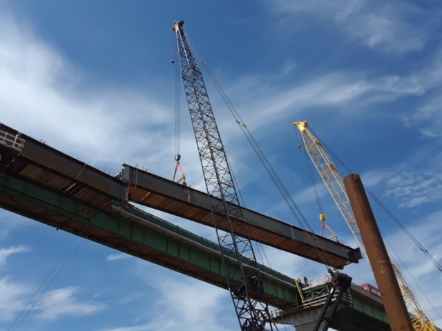 Second approach girder being lowered into place