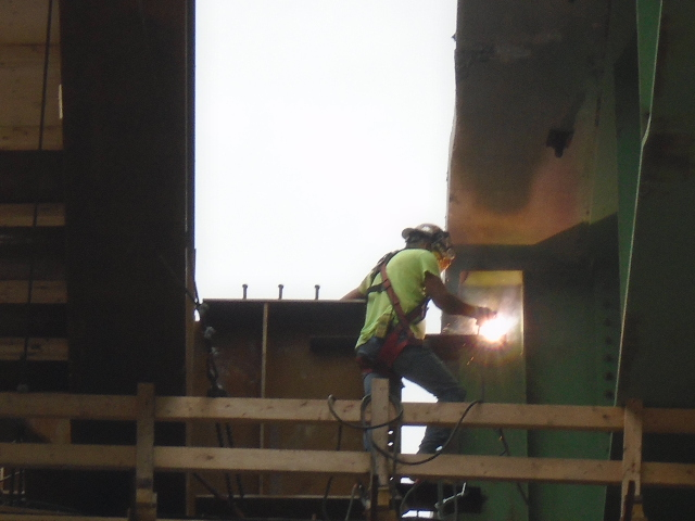 Welding temporary supports to existing girder
