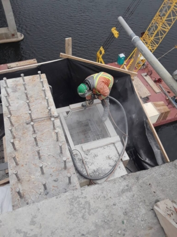 Cleaning the pier top in preparation for concrete placement