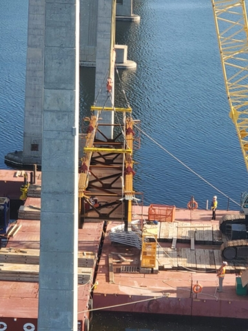 Final girder section being lifted from the barge