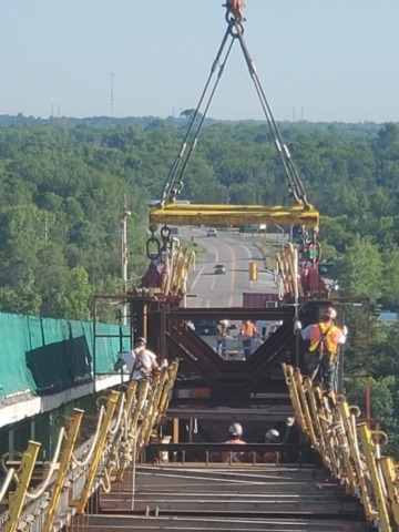 Deck view of the drop-in girder being lowered into place