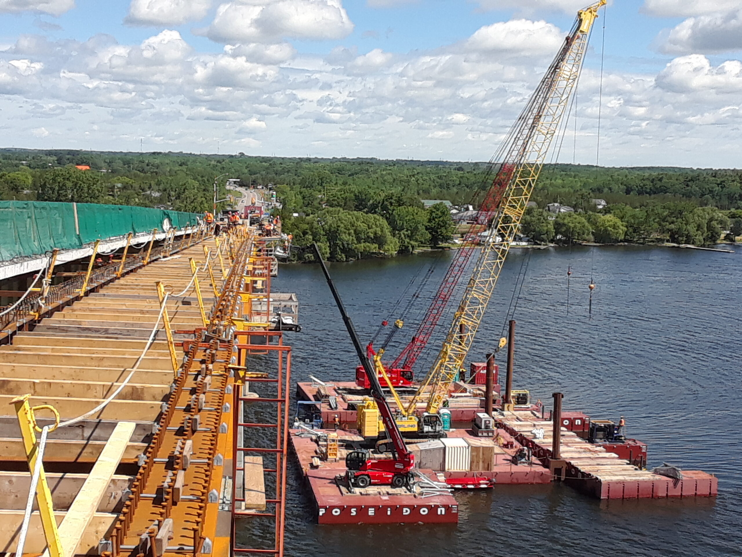 North overview of the new girder section and the barges
