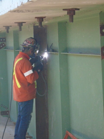 Welding temporary stiffeners to the existing girders