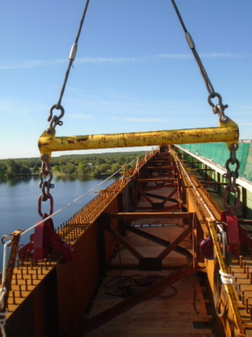 Girder being lifted for bearing work / spreader bar and Crosby clamps