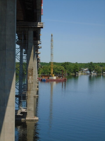 North view of the east side of the bridge, barge and drop-in girder