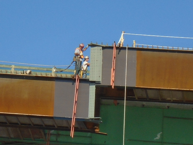 Drop-in girder being lowered into place (pier 7 end)