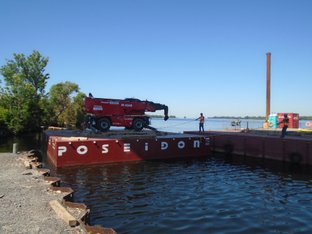 Magni barge being moved into the dock