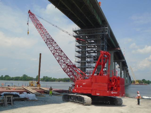 Preparing to load the 110 ton crane on the barge