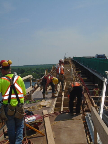 Form-work being placed on the new girder section