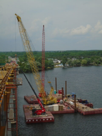 Both cranes lifting materials to the deck for form-work installation / Magni lift fr installation of support brackets