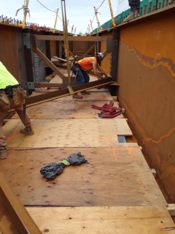 Installing wind bracing n the new girders