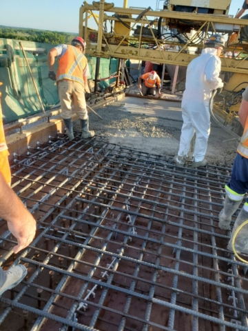 Vibrating and spreading the concrete