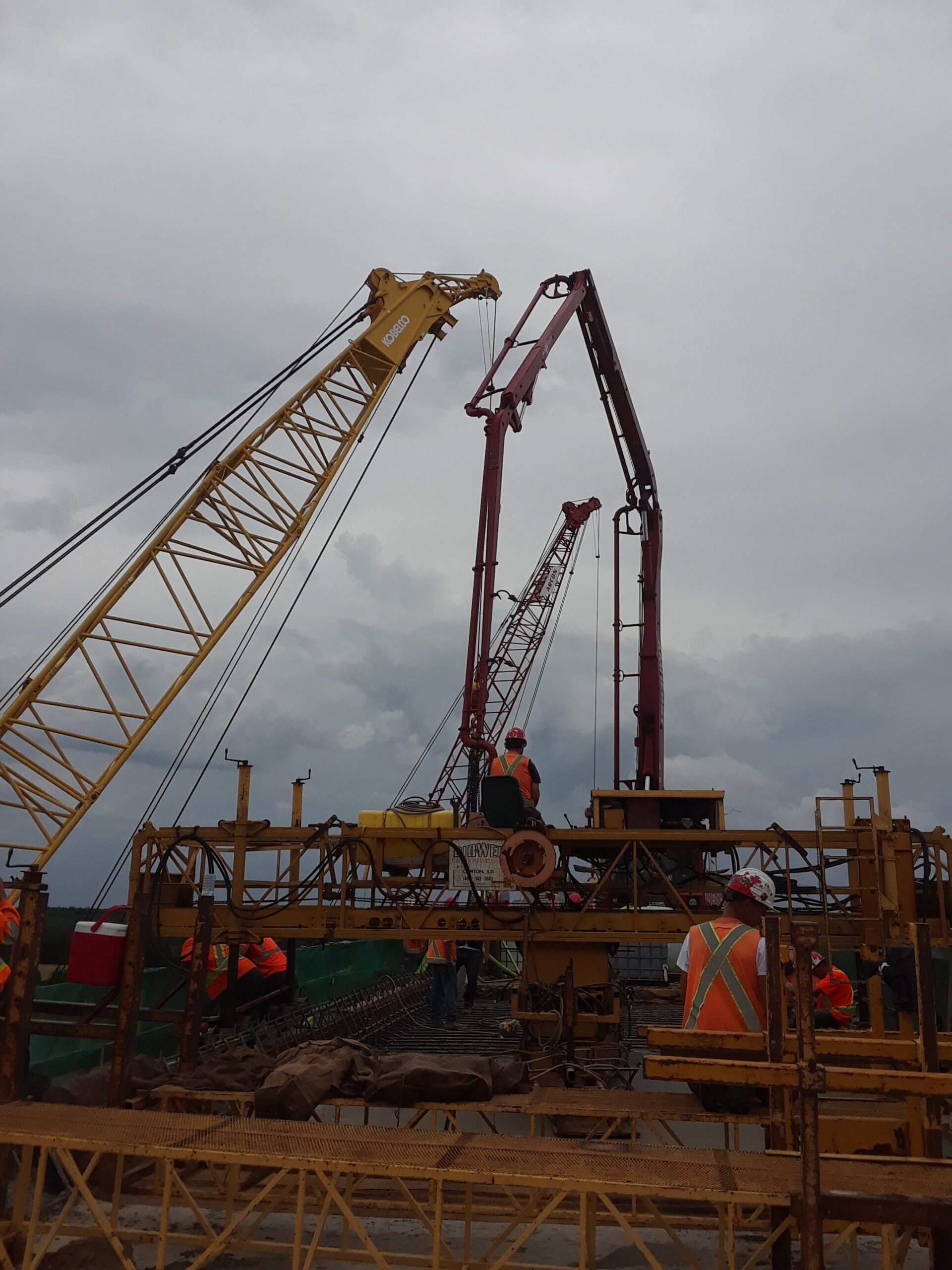Concrete finisher, both cranes and the pump truck