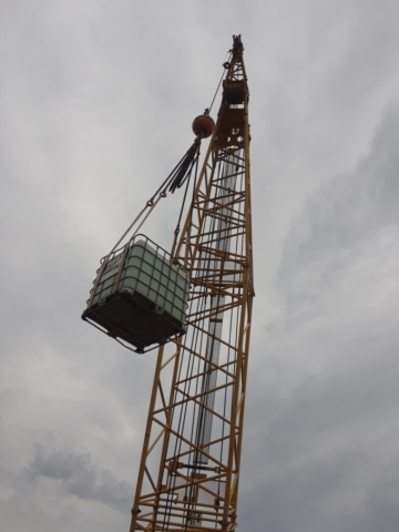 Container of water and burlap being lowered to the deck