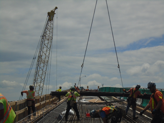 More rebar being lowered to the deck from the crane