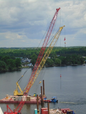 Crane and barge being moved