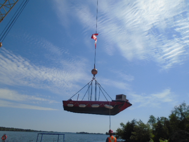 200 ton crane lifting the boat into the water
