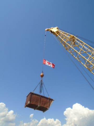 Debris bin being lifted from the deck to the barge
