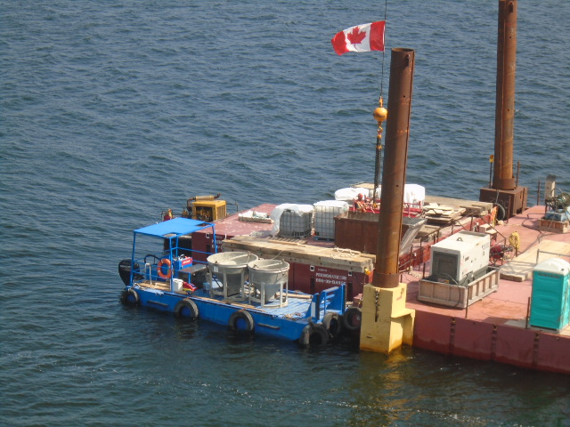 Concrete hoppers being delivered to the barge