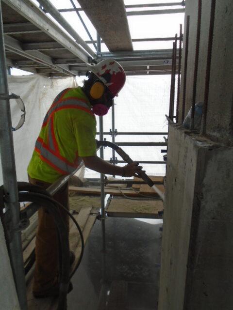 Abrasive blast cleaning on pier 14
