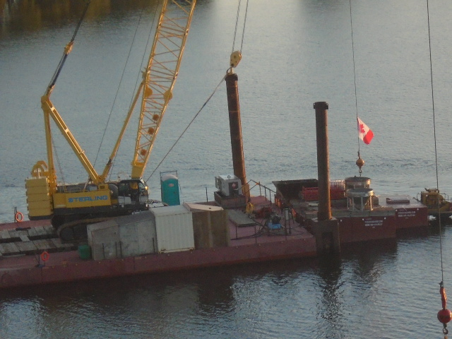 Preparing to lift the concrete hoppers from the barge