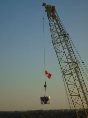 Lifting the concrete hopper to the deck