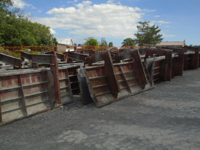 Barrier wall forms on the dock ready to be loaded on the barge