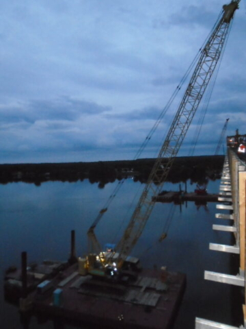 Early morning, setting up the cranes for concrete deck placement