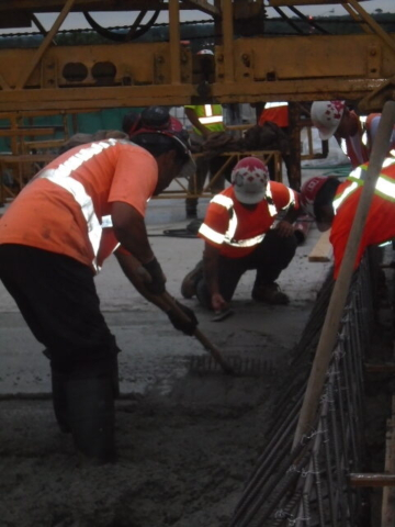 Troweling and spreading newly placed concrete