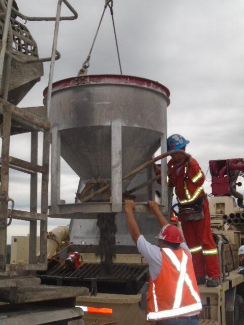 Discharging the concrete hopper into the pump truc