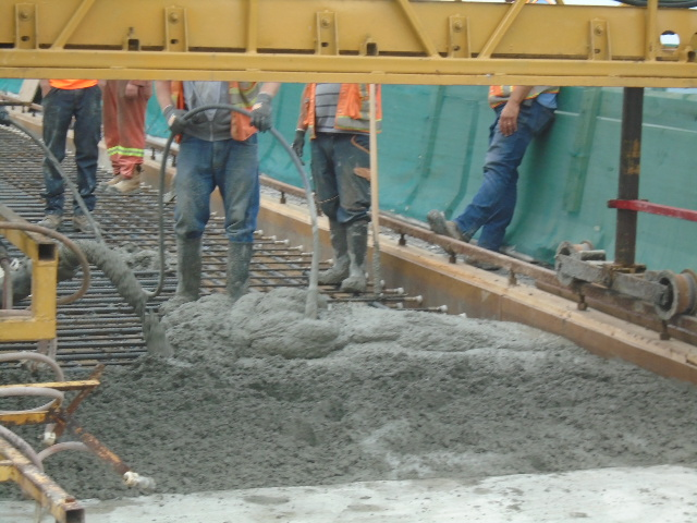 Concrete being pumped and vibrated