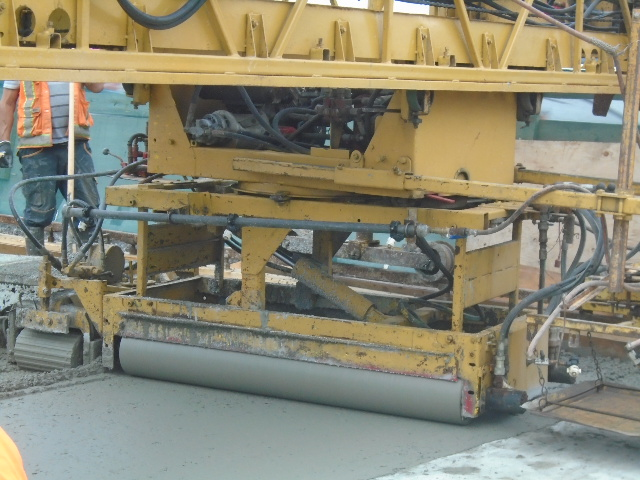 Close up of the roller on the concrete finisher