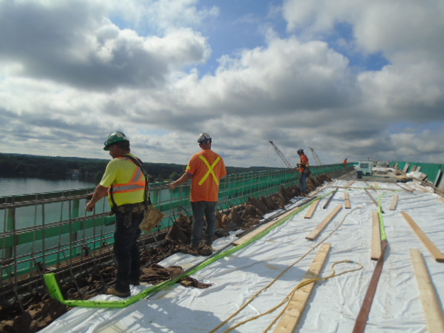 Installing rebar for the barrier wall