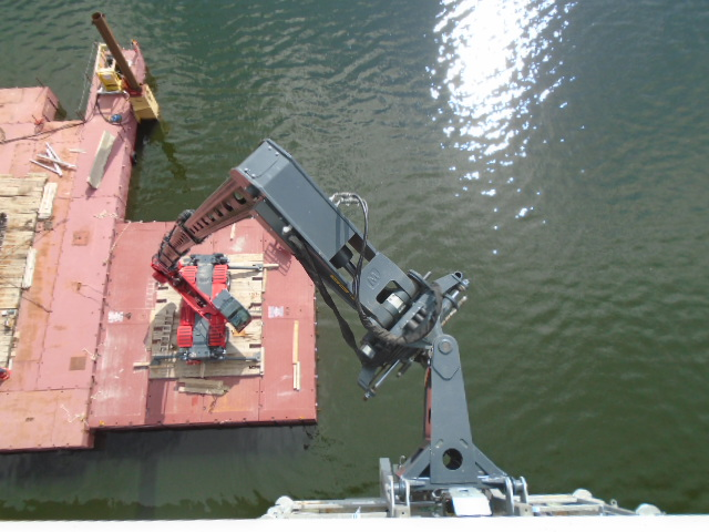 Magni lift extended to the underside of the bridge for splice plate coating